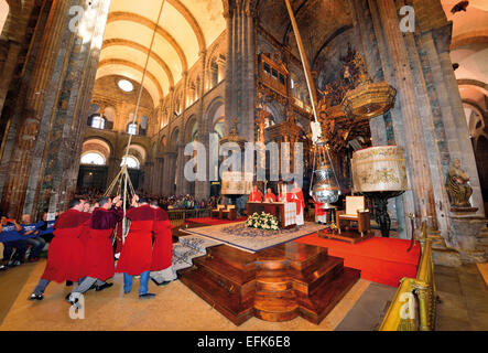 Spain, Galicia: Acolytes swinging the 'Botafumeiro'  during the mass in the legendary Cathedral of Santiago de Compostela - Stock Photo
