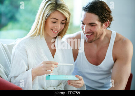 Couple happy with results of pregnancy test - Stock Photo