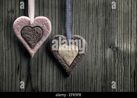 Heart-shaped biscuits with two colors - wood background - Stock Photo