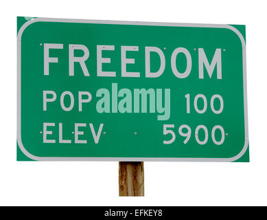 Town Sign Freedom Wyoming Idaho border town. Population 100. Elevation 5900. cut out cutout isolated on white background - Stock Photo