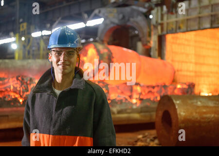 Portrait of steelworker apprentice in steelworks - Stock Photo