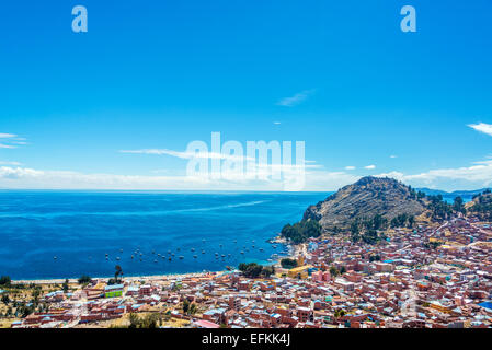 View from a hill of Copacabana, Bolivia with Lake Titicaca in the background - Stock Photo