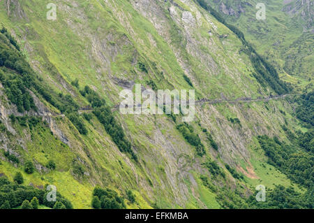 View of a mountain road between Col D'Aubusque (1709m)  and Col du Soulor (1474m). Cirque du Litor. Pyrenees (France). - Stock Photo