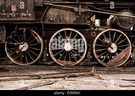 Detail of steam train wheels in railway shed, Inota, Hungary - Stock Photo