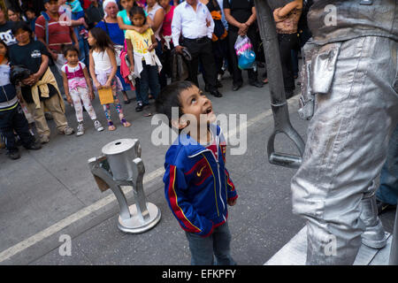Boy smiles at live statue in Guatemala City - Stock Photo