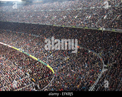 Spectators in a sold out Barcelona football stadium Camp Nou during the match between FC Barcelona and FC Sevilla. - Stock Photo