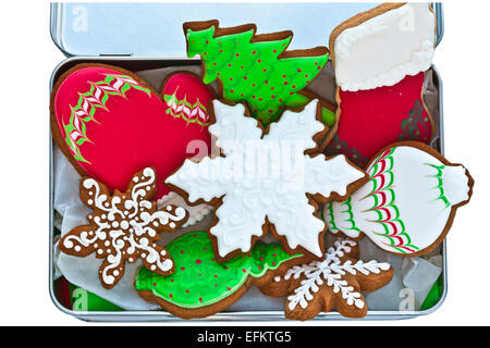 Festive iced gingerbread cookies in tin box. - Stock Photo