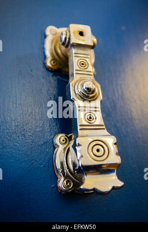 Ornate brass knocker on the door of a Craft Room in a Masonic Hall. - Stock Photo