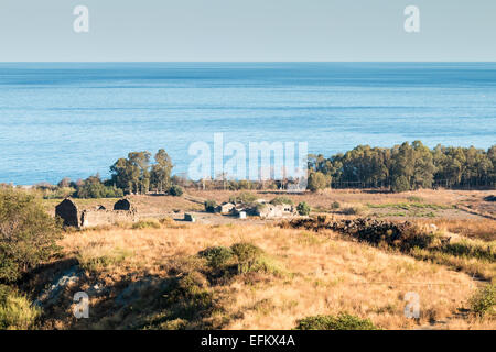 Ruins of an abandoned farm now on the Ionian coast of Sicily - Stock Photo