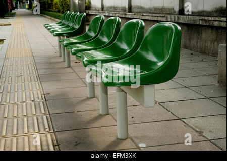 green chairs in waiting area - Stock Photo
