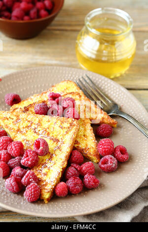 Delicious French toast with raspberries, food - Stock Photo