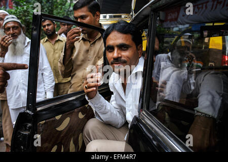 A taxi driver in his Premier Padmini car in Mumbai. - Stock Photo