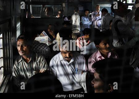 Commuters on a suburban train in Mumbai, India
