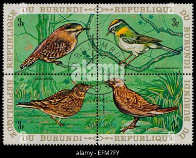 BURUNDI - CIRCA 1970: A set of four stamps printed in Burundi, shows a birds Eurasian Wren, Common Firecrest, Eurasian - Stock Photo