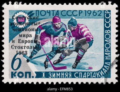USSR - CIRCA 1962: A post stamp printed in USSR shows ice hockey, devoted to the 1st Winter Olympics of the USSR, - Stock Photo