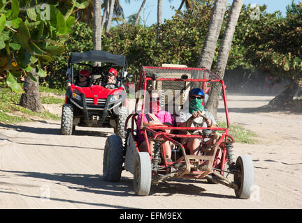 DOMINICAN REPUBLIC. Holidaymakers on a beach buggy safari at Macao beach on the east coast. 2015. - Stock Photo