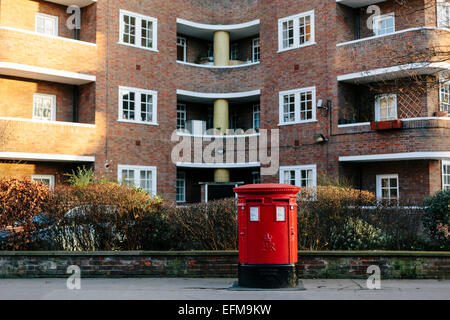 British Red Pillar Post Box in front of Flats in Belgravia London (Landscape format) - Stock Photo