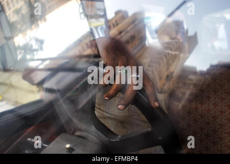 Taxi driver in his Premier Padmini car in Mumbai, India - Stock Photo