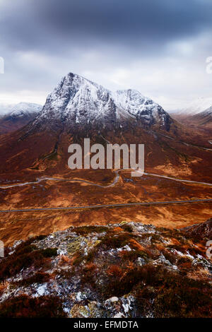 Looking down from Beinn a 'Chrulaiste over the A82 with the Buachaille Etive Mor rising steeply above. - Stock Photo