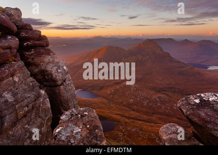 Sunrise from the summit of Cul Mor, Inverpolly, overlooking Cul Beag. - Stock Photo