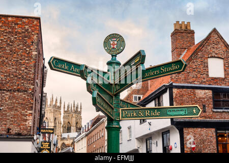 Signpost showing places of interest in Kings Square, York. Focus on sign. - Stock Photo