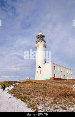 Flamborough Head Lighthouse in the East Riding of Yorkshire, after a winter snow shower. - Stock Photo