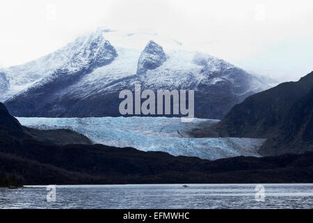 View across Mendenhall Hall Lake to glacier and ice fields in Juneau, Alaska. - Stock Photo