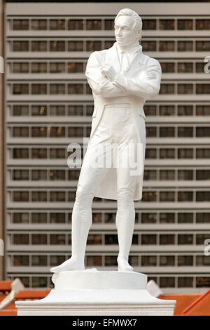 Statue of Sir Stamford Raffles at Boat Quay in Singapore. - Stock Photo