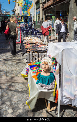Souvenir stall in popular and busy Calle Florida (Florida Street), one of the main shopping streets in downtown - Stock Photo
