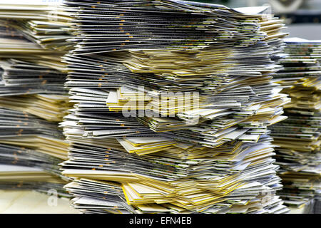 Close up Piles of Plenty Mailing Sheets on Top of the Table at the Office - Stock Photo