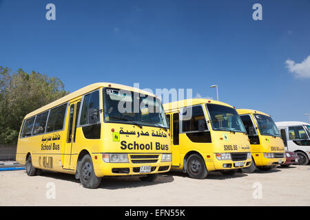 Yellow School Buses in the parking lot in Dubai. December 18, 2014 in Dubai, United Arab Emirates - Stock Photo