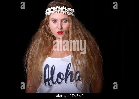 Young female teen with long blond hair and a wreath of flowers on her head. Model released - Stock Photo