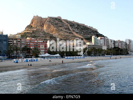 Evening falls at Playa del Postiguet beach in Alicante, Spain with in the background  Santa Bárbara Castle atop - Stock Photo