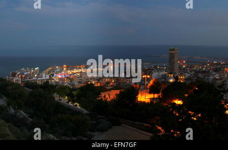 Evening skyline of Alicante, Spain, looking towards the Mediterranean, with Hotel Gran Sol skyscraper on the right - Stock Photo