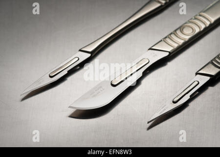 razor sharp surgical stainless steel blade on scalpel used for clinical operations in clean sterile environment - Stock Photo