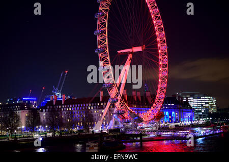 The London eye on Southbank at night - Stock Photo