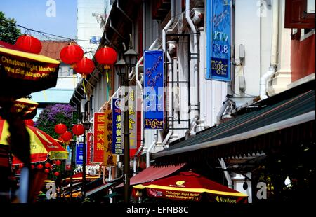 Singapore:  Shops, pubs, restaurants, and red Chinese lanterns line Pagoda Street in Chinatown - Stock Photo