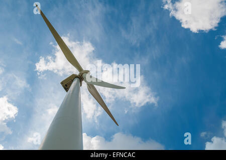 wind turbine blades on blue cloudy sky background - Stock Photo