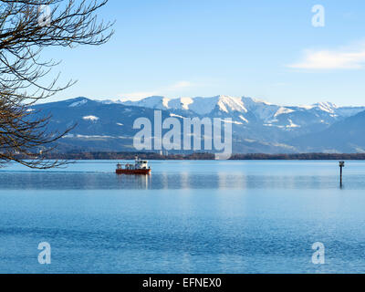 Image of lake constance Bodensee and alps with blue sky and clouds in Bavaria, Germany - Stock Photo