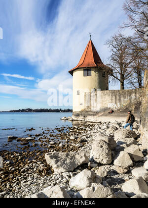 Beach on Lake Constance with stones and tower - Stock Photo