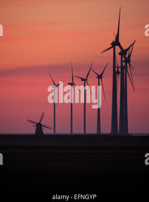 Sunset over the wind turbines in Eemshaven, The Netherlands - Stock Photo