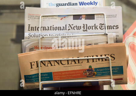 International Newspapers on a stand London - Stock Photo