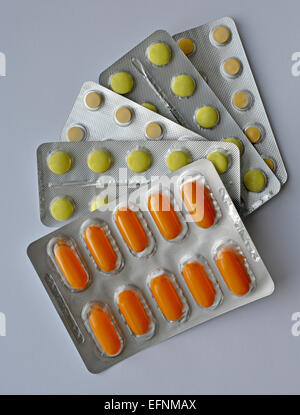 This is a close-up of pills in its blister. Medicaments are multicoloured. - Stock Photo