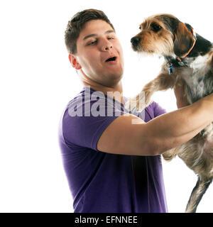 Man Holding His Pet Dog - Stock Photo
