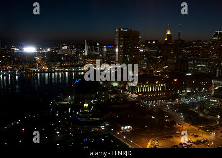 Baltimore, Maryland, USA,the Inner Harbor area of Baltimore as seen at night from the Fells Point area of the city. - Stock Photo