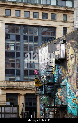 Northern Quarter Manchester Uk. graffiti on a gabel end of building - Stock Photo