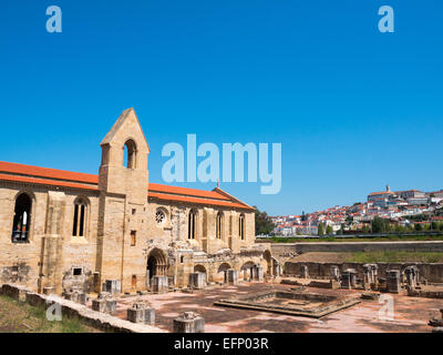 South facade of St Clare-the-Older monastery with Coimbra city in background - Stock Photo