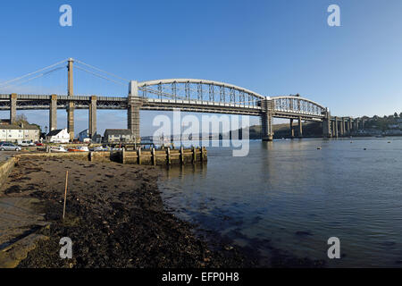 The Royal Albert railway bridge across the River Tamar between Cornwall and Devon.  Viewed from Saltash, Cornwall, - Stock Photo
