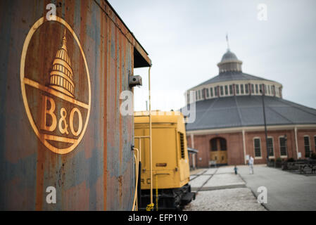 BALTIMORE, Maryland - An aging B&O railway car sits outside the historic roundhouse of the B&O Railroad Museum. - Stock Photo