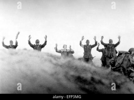German soldiers put their hands in the air as they surrender to allied troops during the battle of Normandy June - Stock Photo